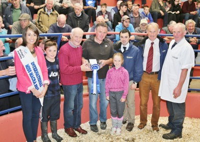 John Cott, Chairman of Kanturk Mart presenting the Reserve Champion Award to Gerald, Jack, and Ellen Devitt, Doon, Kiskeam, at the Kanturk Mart Show & Sale, with International Miss Macra Sinead Guiney, Peter O' Connell (Judge), and Sean Ryan and William O' Flynn of Southern Milling (Prize Sponsors). Photo by Sheila Fitzgerald.